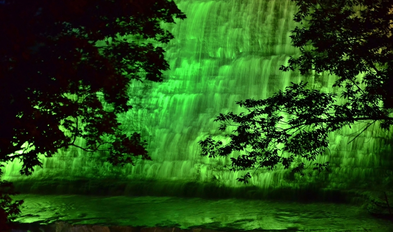 Albion Falls illuminated in Green